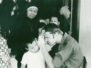 Dr. Marshall examines a patient at the Go-Vat orphanage. Also  pictured is the Mother Superior in charge of the orphanage.